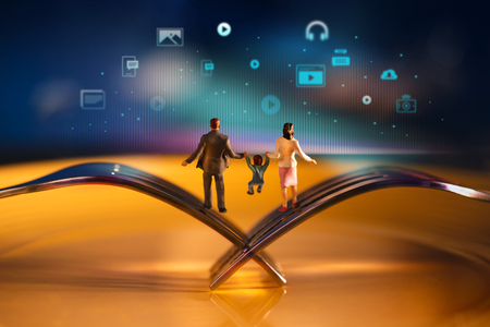 Parent,Kids and New Technology Growing together Concept. Happy Modern Family. Miniature of Father, Mother and Son Balancing body on the Fork. Blurred Media icons as background 写真素材