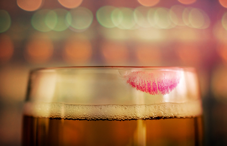 Woman Drinking Beer Concept. Closeup of Glass of Beer with Red Lipstick Mark in Bar or Restaurant. Feminine Mood Stok Fotoğraf
