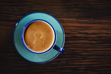 Hot Coffee Latte Cup on Wooden Table. Top View Reklamní fotografie