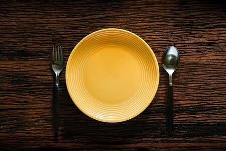 Empty Plate with Spoon and Fork on Wooden Table. Diet Eating Concept. Dish Template. Top View