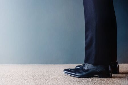 Start Concept. Low Section of Businessman on Formal Business Dress Get Ready to Moving Forward. Cropped Image with Copy Space. Side View Reklamní fotografie