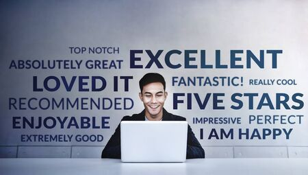 Customer Experiences Concept. a Young Happy Man Reading Positive Review Rating via Computer Laptop. Clients Satisfaction Surveys Online