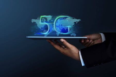 5G Network System Concept. Businessman in Formal Suit Holding a Digital Tablet for Present a New Technology of World Communication, Side view