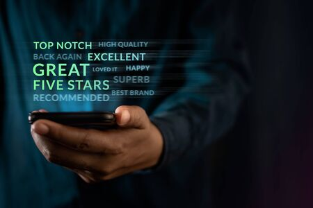 Customer Experiences Concept. Modern Man Reading Positive Review Rating via Smartphone. Clients Satisfaction Surveys on Mobile Phone. Front View
