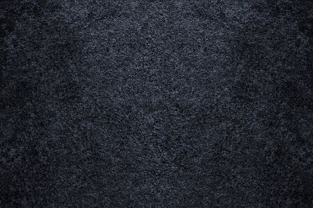 Texture of the Black Stone. Natural Dark Rock Background. Wall and Flooring Banco de Imagens