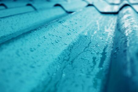 Closeup of Blue Roof Texture. Shot on Rainy Day or after stopped Rain. Selective focus