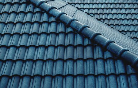 Wet Blue Tiles Roof Pattern. Shot on Rainy Day. Details of Architecture Concept