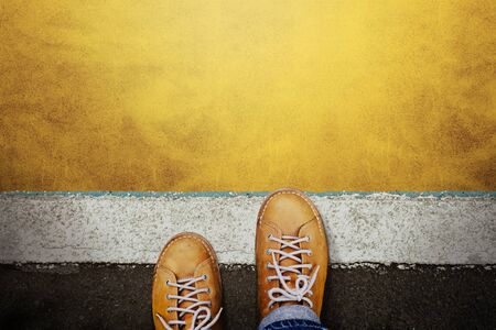 Start and Challenge Concept. a Man on Casual Leather Shoes Steps into the Start Line, Get Ready to Moving Forward or take a Chance to Success. Top View Banco de Imagens