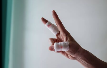 Happy and Positive Concept. Think Positive in Everyday Life. Fingers on First aid Bandaging with Strongly and Happiness Posture