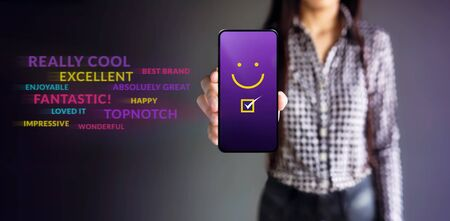 Customer Experiences Concept. Happy Female Client Giving Smiling Emoticon Rating, Positive Review via Smartphone. Clients Satisfaction Surveys on Mobile Phone. Front View
