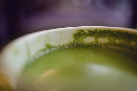 Closeup of Matcha Green Tea Latte in Cup, Extra Close-up Shot