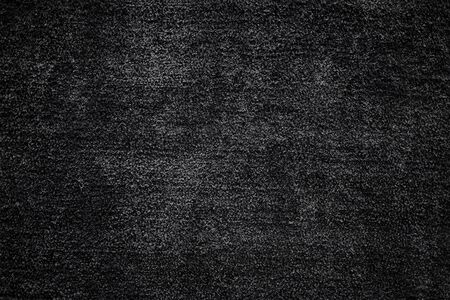 Closeup of Black Carpet Texture. Dark Smooth Fluffy Background