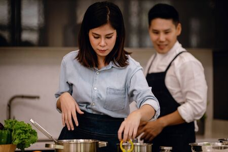 Young Coupple in the Kitchen. Cooking at Home Together. Healthy Lifestyle of Modern People Stock Photo