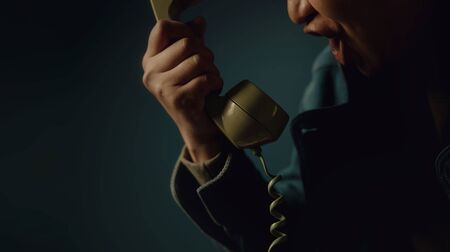 Angry Person Shouting to the Retro Telephone. Cropped image, Vintage Colour Tone