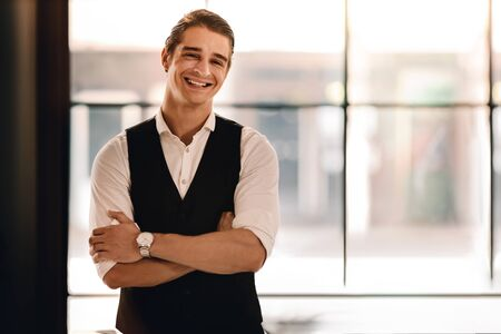 Portrait of a Young Confident CEO or Leader in the Office. Smiling Businessman in Comfortable Posture