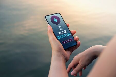 Helathy Lifestyle and Technology Concept. Modern Person Using Online Medicine Application via Mobile Phone to Request a Consultation from the Doctor about their Health