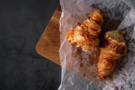 Fresh Croissant Lay on the Cement Table. Breakfast Bakery Light Meal. Top View Stock Photo