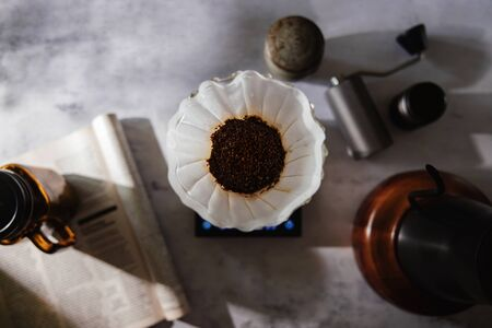 Coffee Drip Concept. Home Brew. Coffee Equipment Lay on the Cement Table. Top View with Natural Sunlight in the Kithchen Imagens