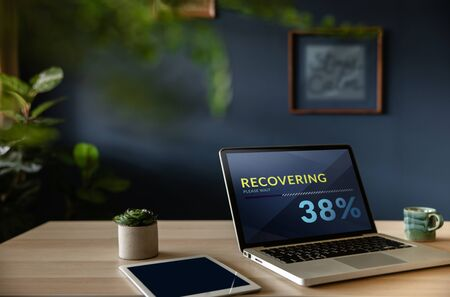 Recovery in Life or Business Concept. Economic Crisis Symbolic. Progressive Bar Loading on Computer Laptop Screen