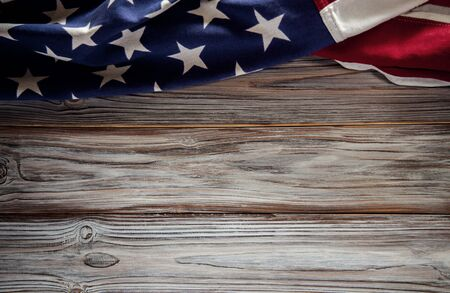 USA Flag Lying on Wooden Background. American Symbolic. 4th of July or Memorial Day of United States. Copy Space for Text