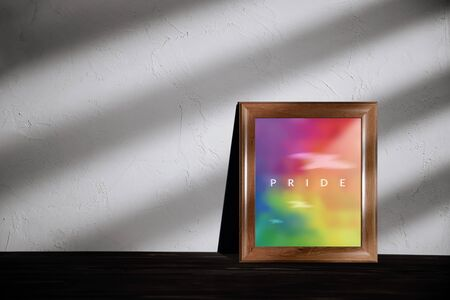 Gay, Homosexual, LGBTQI Concept. Rainbow Color picture with Pride Text in Photo Lying on the Floor in House Imagens - 150196451