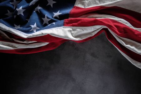 USA Flag Lying on Cement Background. American Symbolic. 4th of July or Memorial Day of United States. Copy Space for Text Imagens - 149745045