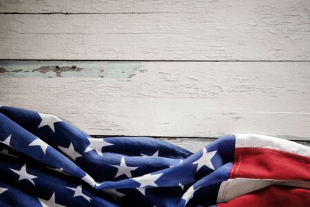 USA Flag Lying on Vintage Weathered Wooden Background. American Symbolic. 4th of July or Memorial Day of United States. Copy Space for Text Imagens - 150196454