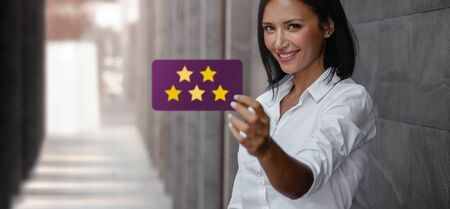 Customer Experiences Concept. Happy Young Business Woman Giving Five Stars Rating and Positive Review on Card. Client's Satisfaction Surveys. Front View Imagens - 150285782