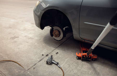 Tire Replacement concept. Garage Tools and Equipment. Car Maintenance and services