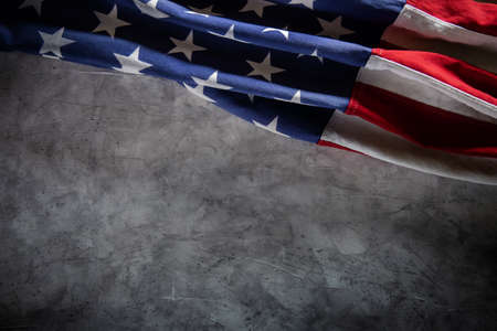 USA Flag Lying on Cement Background. American Symbolic. 4th of July or Memorial Day of United States. Copy Space for Text Imagens