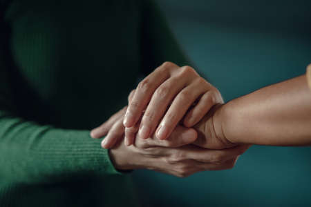 PTSD Mental Health, Encouraging Concept. Touching with Comfortable Hand to Helping a Depressed Person feel better