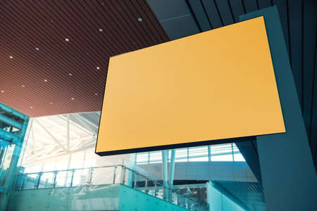 Blank Board for Mockup. Empty Yellow Horizontal Poster. Indoor Scene in Modern Public Building. Clipping Path Included