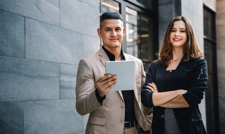 Teamwork or Work Together Concept. Portrait of Businessman and Business Woman Working on Tablet outside the Office Standard-Bild - 156318879