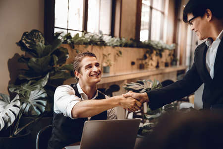 Happy Diversity Business People making Handshake Greeting. Partnership or Teamwork Concept Zdjęcie Seryjne