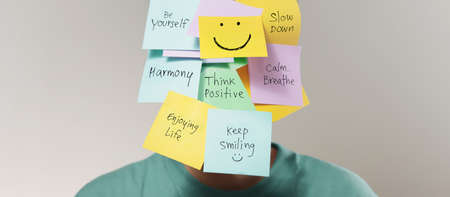 Mental Mind, Enjoying Life Concept. many Sticky Note on Face with Handwriting text. Happy Person