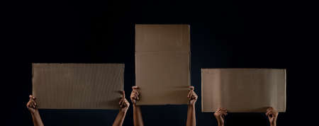 Protest , Mob or Expression Concept. Group of People Raised a Blank Corrugated Paper. Speech Template Texture Background. Front View and Dark tone Archivio Fotografico