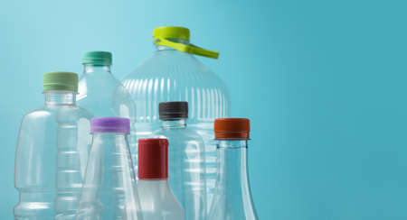 Varieties of Used Plastic Bottles Isolated on blue background. Reuse, Recycle and Zero Waste Campaign