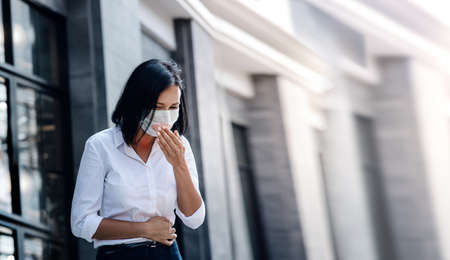 Lung Cancer or  virus Concept. Business Woman with Medical Mask Coughing in City. Virus Spread in Town