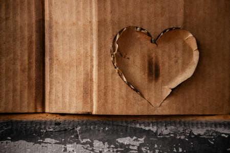 Grunge Burnt Heart on Corrugated Paper Texture Background
