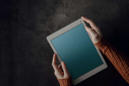 Tablet Mockup Image. Display Screen is Clipping Path. Woman using Digital Tablet on Working Desk