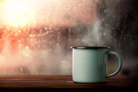 Morning Drink on Rainy Day. Hot Coffee Cup by Glass Window in House. Happiness, Calm or Relaxing Mind on Rainy Day