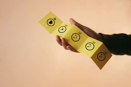 Customer Experience Concept. Happy Client giving Positive Review on Fold Paper. Feedback icon from Poor to Exellent for Products and Services. Client Satisfaction Surveys. Marketing Strategy Stock fotó