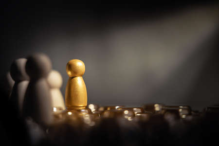 Success in Business or Talent Concept. Stand Out from the Crowd. Different and Individual Unique Person. Spotlight Shining to the Golden. presenting by wooden peg dolls