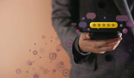 Customer Experiences Concept. Happy Client Using Smartphone to Giving Best Excellent Review Rating for Online Satisfaction Surveys . surrounded by Many Pop Up Feedback from others Floating over a Mobile Phone
