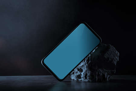 Mockup photo of Mobile Phone. Smartphone Screen . Dark Scene, surrounded by Concrete pieces