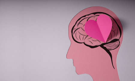 World Heart and Mental Health Day. Paper Cut as Human Head with Heart and Brain. Psychology, Creativity and Positive Mind Concept.Neuronal Stimulation,Medicine and Science Stock Photo