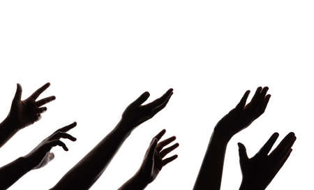 Silhouette of Begging Hands. Group of Hunger Strike People. Impoverished Person Concept. Isolated on White background Stock Photo
