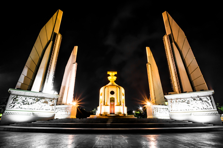 Night scene of democracy monument in bangkok city, thailand photo