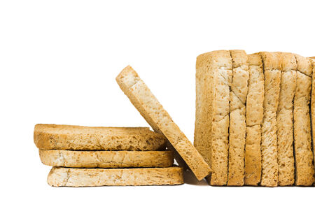sliced crispy baked bread isolated on white background photo