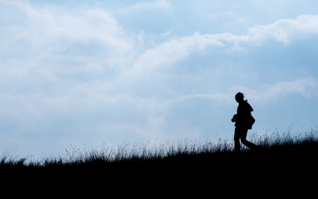 Silhouette of human scale hike and trail on mountain Stock Photo